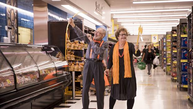 Sprightly seniors dancing in the aisles